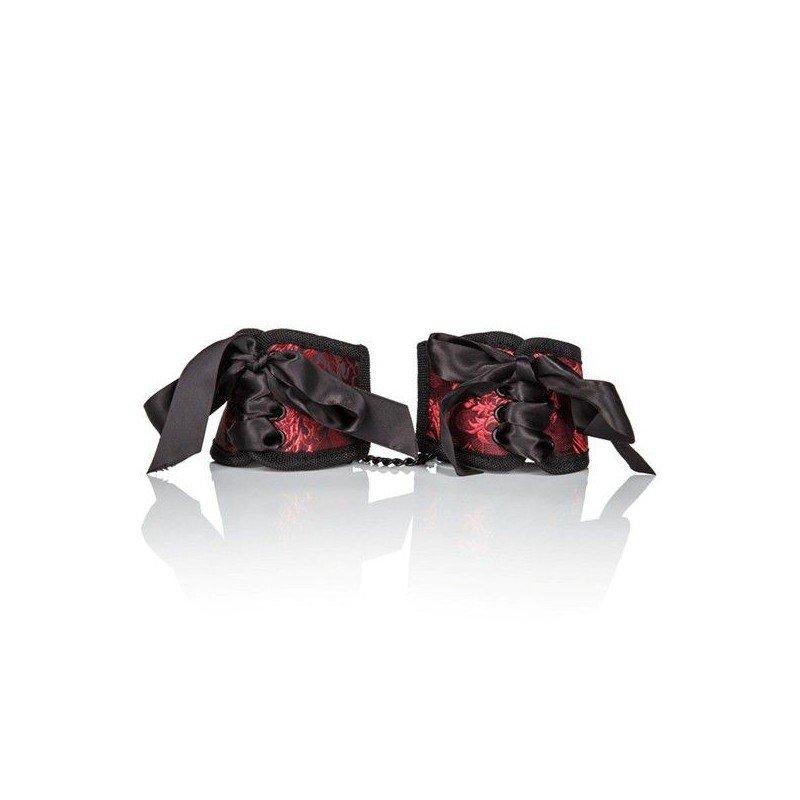 Czerwone kajdanki z ozdobnymi kokardami